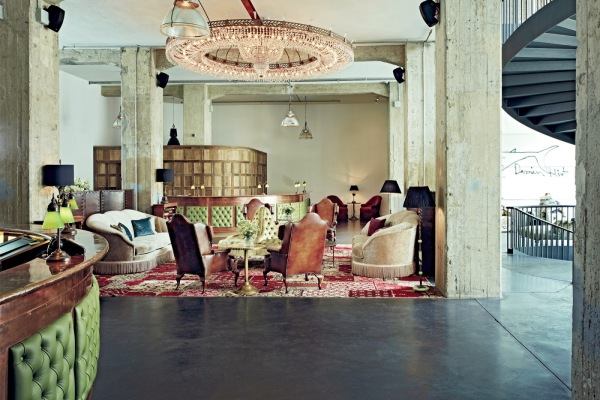Entrance to Soho House Berlin. Clean look with exposed concrete walls.
